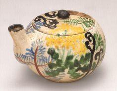 尾形乾山 pot by Ogata Kenzan -- probably not a teapot, some pourer either for sake, or sauce, or water when doing calligraphy and ink painting. Since it does not have a handle, it is obviously not for containing any hot beverage.
