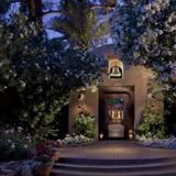 """In addition to the home's stunning main entrance, the """"secret"""" compound offers four master suites (three in the main house, one in the  matching carriage house), each with its own private entrance, bathroom and  courtyard."""