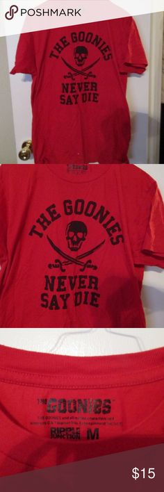 """The Goonies """"Never Say Die"""" red t shirt Size M Hot The Goonies """"Never Say Die"""" red t shirt Size M Hot, measures 18 inches under the armpit measures side to side and 27 inches long. Officially licensed.  Excellent condition. Ripple Junction Tops Tees - Short Sleeve"""