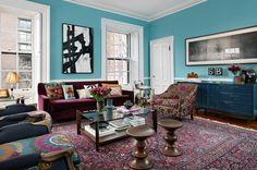 Love the turquoise walls and all the color on color going on in this space! #decor #livingroom