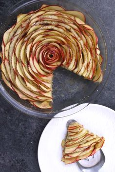 This photo shows serving Cinnamon Roll Apple Rose onto a dessert plate
