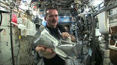 Wringing out Water on the ISS - for Science!  This is one of my fave Hadfield videos.  The kids just love this guy!