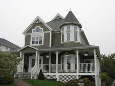 Maritime house grey with white but add red accents like door/chairs/flag