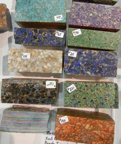 Metal Matrix Block material at 2012 Tucson Gem & Mineral Society Show. Made with real stone, dyes, metal particles suspended in resin.  Labeled as Turquoise, Purple Turquoise, Red Coral, Obsidian, White Calcite & Azurite-Malachite.