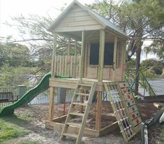 Outlook Fort for outdoor kids play area - I like the chalkboard on the back wall
