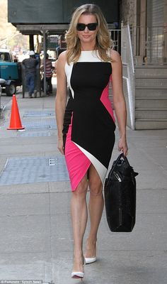 Flawless: Rebecca Romijn donned three different outfits on Tuesday in New York City...