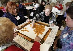 A group of women play in a mah jongg tournament in Ohio this past February to coincide with an exhibit curated by Melissa Martens. (AP/Amy Sancetta)
