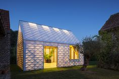 "Using workaday materials, architect Indra Janda creatively constructs a backyard retreat that looks opaque during the day and glows at night.  In the rural Belgian town of Smetlede, polycarbonate—a type of extra-strong plastic—is often used to sheathe porches and verandas. When architect Indra Janda designed what she calls a ""garden room"" on her parents' estate, the humble, inexpensive, and easy-to-work-with material was a natural choice. ""But I wanted to use it in a different kind of way,""…"