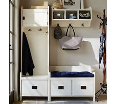 Small entry? No worries! Use your vertical space by installing a cabinet or shelving to store coats, rain boots and all the items you need to get ready in the morning.