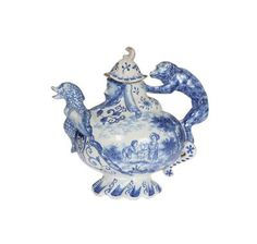 An unusual Delft blue and white teapot, after a Du Paquier design, probably 19th Century, modelled with a monkey handle, the spout formed as a dolphin being ridden by a bearded Neptune, blue painted mark. 18.5cm | Thomas Watson Auctioneers