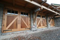 So your garage doors might not be the most glamorous part of your home's exterior, but they deserve some attention! When you think about how much space the front of your garage doors take up, you realize just how much… Continue Reading → Custom Garage Doors, Modern Garage Doors, Wood Garage Doors, Garage Door Design, Timber Frame Garage, Timber Frame Homes, Timber House, Barn Door Designs, Interior Barn Doors