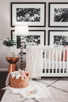 Black and white nursery with copper accents. Love the oversized photo prints on the wall! Perfect as a gender neutral look that will grow with your baby.