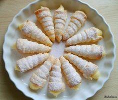 Conos de hojaldre rellenos de crema pastelera. ¡No podrás probar sólo uno!
