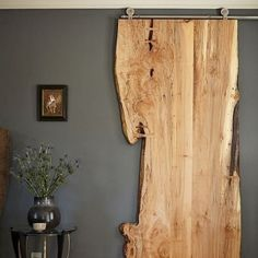 Driftwood sliding door on the eastern wall for wood element and perfect feng shui