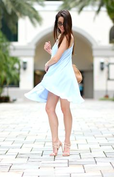 Loving this light blue shift dress with asymmetrical shift silhouette. It can be dressed down with flats as a casual summer outfit or up with cute heels or wedges for a date night.