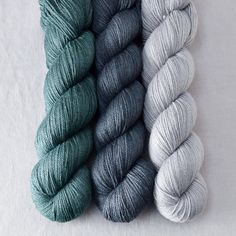 Trio in Woodbury Three skeins of Woodbury, chosen by someone here in the studio to work together in a stunning three-color shawl pattern. Woodbury is the finger