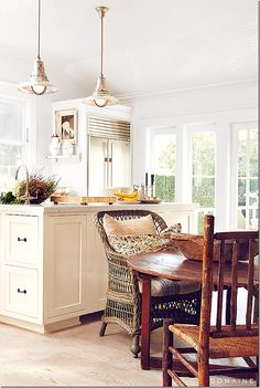 white kitchen with antique furniture