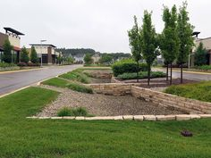 he entrance to the Argenta Hills commercial development in Inver Grove Heights, Minn., features a landscaped median that doubles as a stormwater collection area. Urban Landscape, Landscape Design, Garden Design, Wet Design, Retention Pond, Inver Grove Heights, Water Solutions, Water Management, Rainwater Harvesting