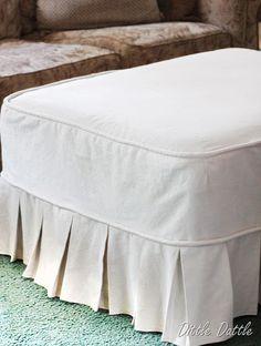 drop cloths over an ottoman