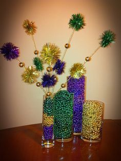 Mardi Gras centerpiece with vases filled with beads