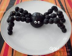 Kitchen Fun With My 3 Sons: Spooky Spider Snack (plum, pretzel sticks and grapes...plus edible eyes!)