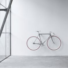 Wall mount for road bike or fixie bike. Including wall attachment Maximum length of handlebar 48 cm Dimensions: 30 cm deep 24 cm wide 11 cm tall Materials used: Birch Multiplex untreated