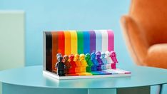 Here's why the designer's so proud of it. Rainbow Flag, Rainbow Colors, Lego Website, Best Lego Sets, Lego City Sets, Classic Board Games, Lego Figures, Family Set, Cool Lego