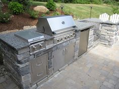 Outdoor Kitchen, MASummerset stainless steel grill and appliances.