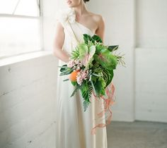 jungle inspired bouquet Lush + Tropical Wedding Inspiration  http://greenweddingshoes.com/lush-tropical-wedding-inspiration/?utm_source=Green+Wedding+Shoes&utm_campaign=77520cec30-Daily_RSS&utm_medium=email&utm_term=0_97f3318193-77520cec30-111528945
