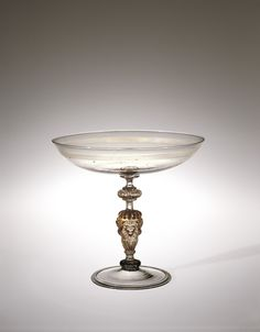"Drinking Tazza, 1550-1599. ""An Englishman traveling in Italy in the 17th century observed ""for the Italians that love to drink leisurely, they have glasses that are almost as large and flat as silver plates, and almost as uneasie to drink out of. . . ."" The tazza is a most sophisticated glass for the drinking of red wine. Such glasses, which required a steady hand, are often seen in Italian pictures of the 16th and early 17th centuries."" Corning Museum of Glass."