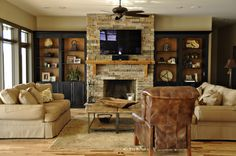 Like the stone on the fireplace with shelves on either side.  Would go with white shelves.  TV too high up.