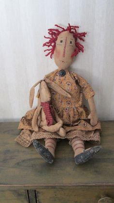 Primitive Raggedy with Bunny by Bettesbabies Primitive Doll Patterns, Primitive Folk Art, Primitive Crafts, Handmade Crafts, Handmade Dolls, Ann Doll, Raggedy Ann And Andy, Doll Quilt, Kokeshi Dolls