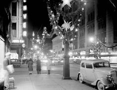 ~ 16th Street in 1943, notice the Santa atop the D&F Tower!~