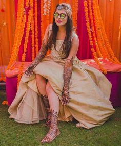 wedding mehendi function bridal with mehendi on hand & leg