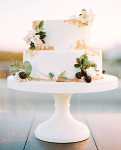 Maggie Austin Cake created this two-tier cake ringed with sugar flowers and blackberries for a rooftop wedding in Washington D.C.