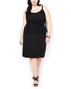Start your spring wardrobe with this gorgeous plus-size dress! You'll love its classic black hue, as well as its fringe detailing at front. Made with a soft and stretchy fabric, it also features a V-neck, wide adjustable straps and a flattering fit. Wear it with heels for a night out!