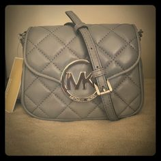 """Michael Kors Steel Grey small quilt crossbody NWT Classy Michael Kors """"Steel Grey"""" Fulton quilt small leather crossbody. Adjustable leather/chain crossbody strap. Fold over clasp closer with magnet. Back exterior has slip pocket for convenience and wall slip pocket on interior. Authentic with tags as shown! Measures 2.5""""D x 6""""H x 6"""" across MICHAEL Michael Kors Bags Crossbody Bags"""