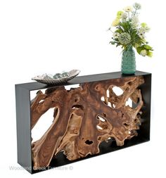 Our modern root console table feature a handcrafted natural twisty log centerpiece surrounded by a contemporary metal frame.