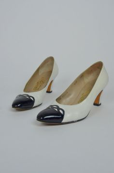 Super sweet 1980s Ferragamo heels! Done in a white leather with a patent black leather toe cap. Low comfortable heel. Leather soles. Comes with original box, and price tag of $218.00! ♥   Good Vintage Condition: some creasing, and discoloring mainly around sides of toes and backs of heels. These have some white shoe polish around edges. Prices Accordingly ♥♥  SIZE: 6.5 TAG:6.5 B BRAND: Salvatore Ferragamo Measurements: Width: 3 Length of insole: 9.25 Heel: 2.5  * Any overpayment exceeding $4…