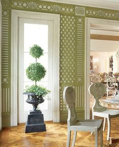 Hand-painted trellis wallpaper in the sunroom with antique furniture, in a Georgian-style house in Richmond, Virginia by Bunny Williams Image AD: