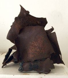 Three pieces of scrap metal found on the rail line in a small town in Montana during a bathroom break. By Rick Farrell.
