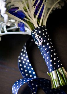 Polka dot anchor wedding bouquet- could wrap girls with one band width at top of bouquet to match guys ties