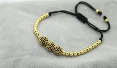 """""""Shadow"""" Macrame Beaded Bracelet - 23$ Crafted with three 8mm 18kt gold plated zircon discos ball and 4mm gold plated beads.  Crafted with 1mm nylon cord  Adjustable size. Can fit size 6cm to 22cm.   Colors: Gold , Rose Gold , Silver ,Black"""