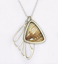 Beautiful butterfly wing necklace, made with a real butterfly wing pendant and a sterling silver wing pendant