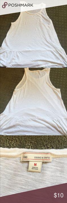 Medium white ruffle gap tshirt tank Worn maybe once, super cute white tshirt tank with a ruffle on bottom - peplum style. GAP Tops Tank Tops