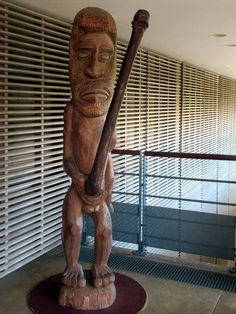 This sculpture at the Tjibaou Cultural Center in Noumea, New Caledonia, South Pacific, represents a mythical giant who used his penis to carve a passage through Olal Reef off North Ambym, Vanuatu. Cultural Center, Vanuatu, South Pacific, Lion Sculpture, Carving, Culture, Statue, Art, Art Background