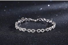 Ladies 925 Sterling Silver & Micro Pave Crystal Repeating Infinity Symbol Bracelet. Perfect holiday gift, birthday gift idea or Valentine's Day jewelry for ladies and girls of all ages. Everything is possible when you believe in yourself! Our are passionate about the infinity sign and everything it represents. Perfect for leisure wear or the perfect yoga jewelry accessory.