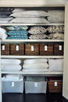 Organized Linen Closet with woven bins from Target and handwritten labels | Honey We're Home