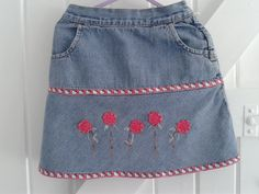BABY BLUES 'Pink Kitty' skirt. re-worked with added flower detail and ;little kitty' ribbon interest. 3-4 YEARS          £7.50
