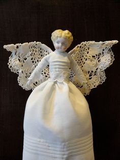 Antique re-dressed angel doll.